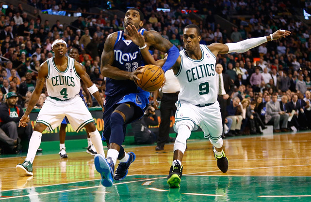 Rajon Rondo strips O.J. Mayo of the ball during overtime of last night's Celtics-Mavs game. Boston blew a 14-point third quarter lead but prevailed in double-overtime, 117-115. (Jared Wickerham/Getty Images) GALLERY: Rare Photos of Rajon Rondo