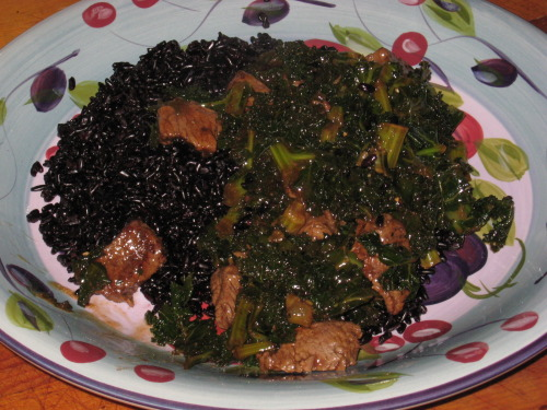 Kale beef garlic stir-fry on black rice.