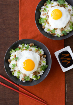 yummyinmytumbly:  Loco Moco  Loco Moco  YIELD: 2 servings   COOK TIME: 30 minutes   TOTAL TIME: 8 hours  ingredients:  For Coconut Rice:1 cup white sticky rice*1/2 cup coconut milk For Soy Reduction:1/4 cup low-sodium soy sauce**2 tablespoons light brown sugar, packed1/2 teaspoon sriracha For Pork:1/4 pound ground pork1/8 teaspoon salt1/8 teaspoon black pepper For Topping:1 teaspoon vegetable oil2 large eggs2 green onions, thinly sliced2 tablespoons roughly chopped fresh cilantro *Sold as Sho-Chiku-Bai sweet rice, or sometimes just called sweet rice, white sticky rice can be found at specialty grocers and Asian food stores. You can use sushi rice instead, though it may need more liquid and a slightly longer cooking time.**Regular soy sauce won't work here; it makes the reduction too salty.  directions:  Combine rice with 1 cup cold water; cover and refrigerate for 6 to 8 hours. Pour rice and any remaining liquid into a saucepan. Stir in coconut milk and bring to a boil over medium heat. Cover and reduce heat to medium-low; simmer for 10 minutes, or until rice is tender and liquid is absorbed. Remove from heat; keep covered and let stand for at least 5 minutes. In a small saucepan, combine soy sauce, 2 tablespoons water, brown sugar, and sriracha. Simmer over medium heat, stirring occasionally, until thickened and reduced by half, 6 to 8 minutes. Heat a large nonstick skillet over medium-high heat. Add pork and season lightly with salt and pepper. Cook, breaking it up with a wooden spoon, until it begins to brown, about 7 to 9 minutes. Transfer to a bowl and cover with aluminum foil to keep warm. Carefully wipe out skillet (it may be hot) and return to medium heat; brush with vegetable oil. Crack eggs into opposite sides of the pan to keep them from running together. Cover and cook for 3 to 4 minutes. If you prefer firmer yolks, cook for another 1 to 2 minutes. Divide rice between serving bowls. Top with ground pork and a fried egg. Drizzle with soy reduction, sprinkle green onion and cilantro on top, and serve.