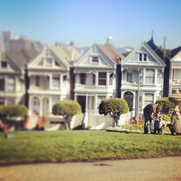 This is an adorable family taking pictures outside the Full House row of houses because sometimes life conspires to kick you full-on in the ovaries. (at Alamo Square)