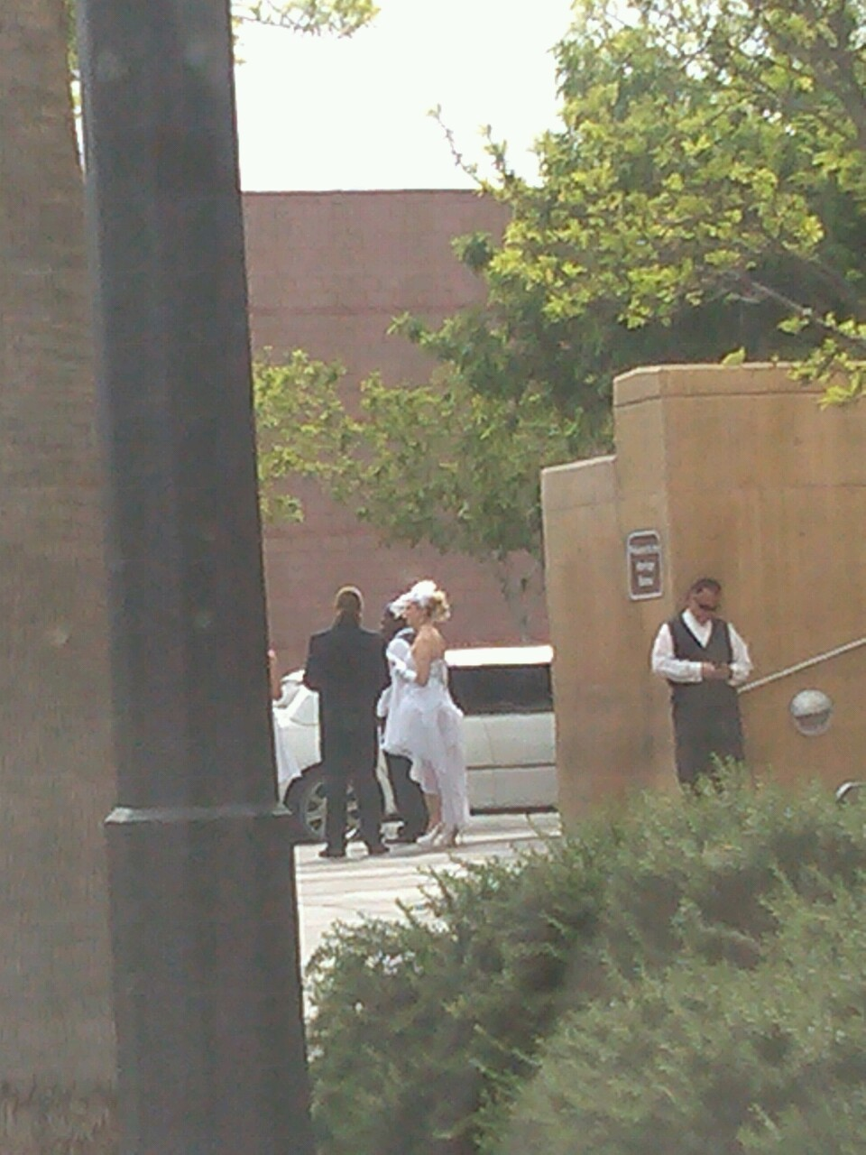 Omg a wedding is happening right now on the street omg how exciting