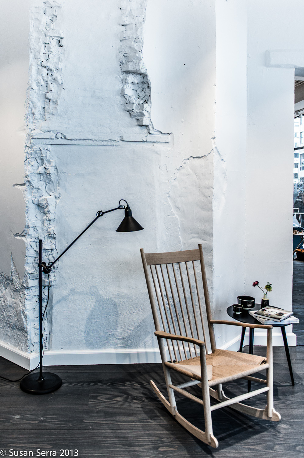 A vignette of the new Fredericia furniture showroom in Copenhagen. A fresh take on classic furniture set against a centuries old wall. The dark gray wide floor boards was also a new take on Scandinavian flooring, most often having a natural finish.