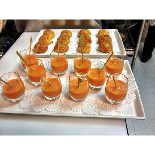 Tomato Gazpacho shots with Octupus Escabeche skewers. Blue Cheese Gougeres in the back.