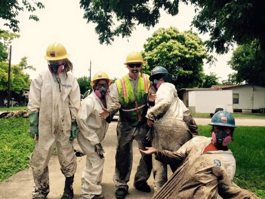 AmeriCorps members take a moment for a photo during one of their muck and gut operations in Texas.
