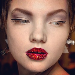 officialstyledotcom:  3-D cateyes, bedazzled lips, and pixie cuts-for-all, backstage at Dior Couture. CE