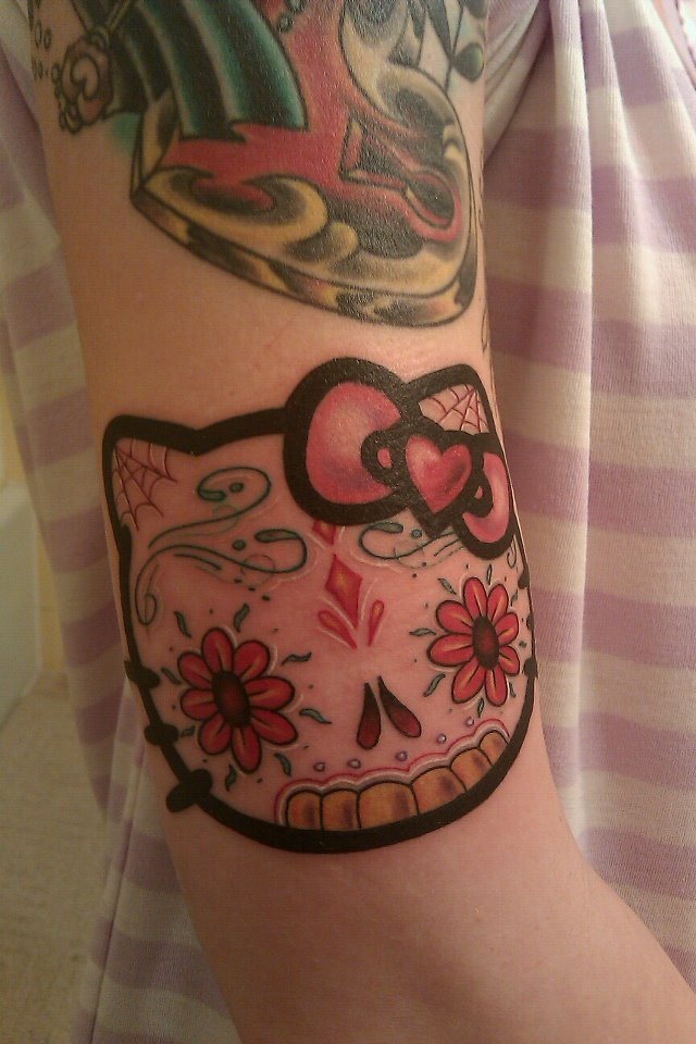 fuckyeahtattoos:  For my love of Hello Kitty. Done by Tim Hodge at Ascension Tattoo, Twin Falls, Idaho.