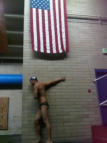nathangadrianfan:  great shot of him stretching…esp with the american flag hanging above :)