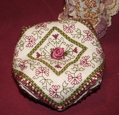 Medieval Garden Biscornu. Original design by Rainburst Embroidery.