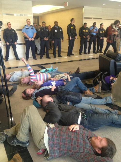 "thepeoplesrecord:  The Tar Sands Blockade has launched a ""die-in"" at the TransCanada offices in Houston, Texas to protest the Keystone XL pipeline.  Activists in Massachusetts have also engaged in direct action in TransCanada's office telling stories of the Keystone's destructive consequences.  Solidarity actions are currently taking place all over the country today, including right now in Detroit & tonight in Austin.  From the Tar Sands Blockade: ""This action kicks off a new phase of the Tar Sands Blockade targeting the corporate and financial infrastructure behind the Keystone XL pipeline. TransCanada's pipeline uses seized land to transport toxic tar sands oil through Texas and Oklahoma communities, in order to export it from Houston ports. These dangerous business practices and the backlash from communities across the country make this pipeline a toxic investment for our state and TransCanada's corporate lenders."" Photo source  Commendable."