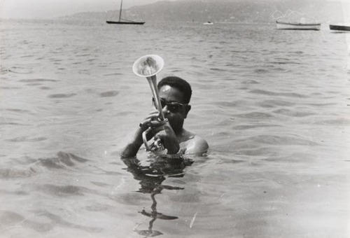 Dizzy Gillespie playing his trumpet on the French Riviera circa 1960.