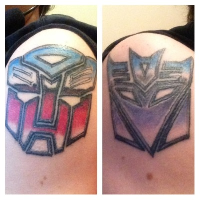 Done by Dutch at Infinty 13 Studio in Dallas, TX. They are the transformers symbols, Autobots and Decepticons.