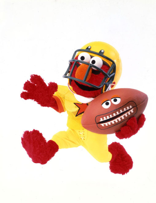 sesamestreet:  It's not just the day of the big game… it's also Elmo's birthday! Happy Birthday Elmo, we hope it's SUPER!