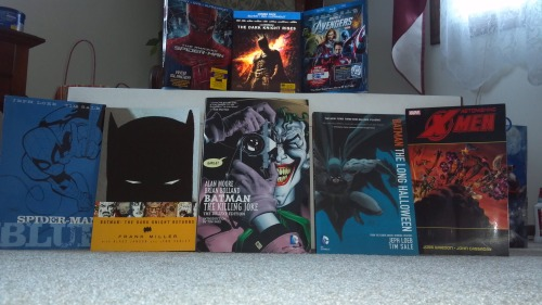 Justin's Christmas haul The Amazing Spider-Man Blu-Ray The Dark Knight Rises Blu-Ray The Avengers Blu-Ray Spider-Man: Blue graphic novel Batman: The Dark Knight Returns graphic novel Batman: The Killing Joke Batman: The Long Halloween The Astonishing X-Men Book 2 graphic novel Comic long box
