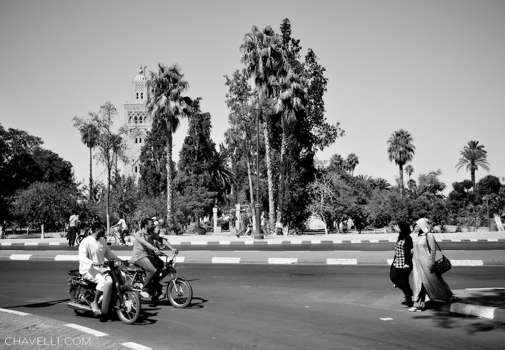 Streets of Marrakech, with the Koutoubia Mosque in the background. http://chavelli.com/blog/photography/black-and-white-shots-from-the-medina