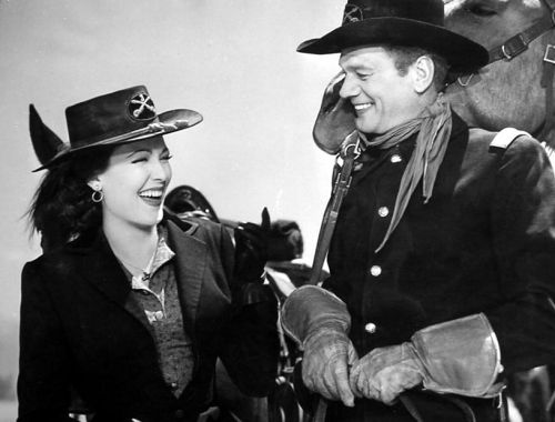 Linda Darnell and Joseph Cotten have a laugh between scenes of Two Flags West