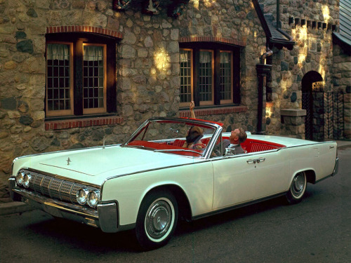 werstd16:  1964 Lincoln Continental convertible with the best color combination possible and whitewalls. Wow.