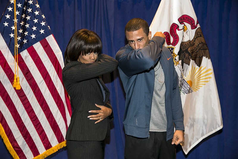 Image description: From the White House:  The First Lady and 49ers QB Colin Kaepernick, Kaepernicking for Let's Move! Active Schools.