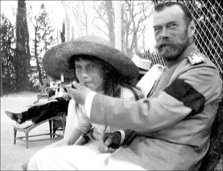 varietas:  Tsar Nicholas II teaching his daughter Grand Duchess Anastasia how to smoke.  Picture: Zlatoust City History Museum Private pictures of the Russian royal family found in a remote Urals museum