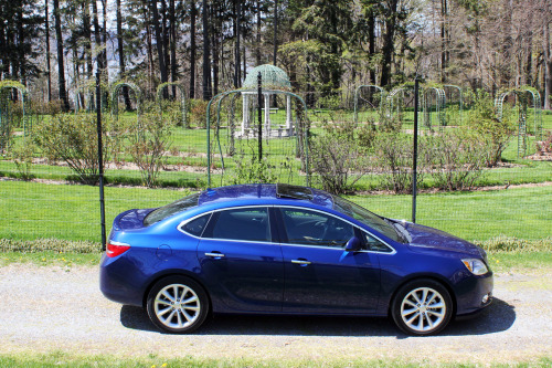 MotoReview: Buick Verano Turbo Premium Gone are the days of gas guzzling, big behemoth Buick boats with 8-cylinder engines and beautiful bodies decked in endless blinding chrome. Enter a new age, with the new Regal/GS, LaCrosse, and with the addition of the Verano, there's a pretty solid lineup of cars for Buick. And the Turbo Premium adds a somewhat affordable alternative to the sport line for other luxury brands like Audi's A4/S4. Most don't know it, but Buick is the oldest active domestic car manufacturer in the U.S. today. The company was founded in 1899 by David Dunbar Buick under the name Buick Auto-Vim and Power Company and was later incorporated as the Buick Motor Company by William C. Durant, the creator of General Motors. Buick was General Motors' first car company so one can only assume there would be no GM without Buick. Since the early years, Buick has been on the higher end of the GM spectrum, second only to Cadillac, and that still hasn't changed much. Fast forward 7-decades or so after the first Buicks hit the streets and the compact executive car was born with the BMW 3-Series. Since then, there have been a number of manufacturers to follow suit. Mercedes built the 190, later called the C-Class. Then Audi released the 80, later the A4. Lexus jumped on board in the late 1990s with the IS and recently the Cadillac ATS made its way into the compact executive segment. Some have even called the Premium Verano a compact executive. Could they be right? Expectations were really nonexistent before the Verano Turbo arrived, but when it finally pulled into the driveway, it had a deep shine from the Luxo Blue paint and it looked charming gleaming in the sun. This particular car was a brand new Verano Turbo Premium with less than 400-miles on the clock. The base price is under $24,000. The price as tested for the Verano Turbo Premium? $31,695 which included optional navigation and sunroof, as well as standard goodies like; rear vision camera, blind spot alert, heated seats & steering wheel, 6-months of OnStar, keyless/remote start, leather interior, IntelliLink computer system, 18-inch wheels, fog lamps and much more. After selecting the Turbo in premium trim and pricing out every single option available, you'd still be under $34,000. Try doing that in a Lexus or Audi. Studying the car reveals that everything is a little different, tweaked, foreign… And that makes sense when you realize the details. The Verano is built on the GM Delta II platform (developed in Germany) which it shares with the Opel Astra, Chevy Cruze/Volt, and Buick Excelle GT (for the Chinese market), and while its closest North American counterpart is the Chevy Cruze, they do not compare. For starters, the Verano Turbo gets the same 2.0L Ecotec engine as the Buick Regal GS which produces an impressive and surprising 250-hp, 260 ft-lb torque propelling the car from 0-60mph in just over 6-seconds. And thanks to a pretty unique suspension, the Verano handles turns like a sports car, yet the ride is comfortable and you don't have to clench every time you hit a bump any larger than a crack. The car is available in all trims with an automatic transmission, but you'll have to select the Turbo for a manual. The 6-speed automatic was so responsive and quick to shift, you might be happy with the convenience. Still, I want that manual. On the inside you get a choice of ebony, cashmere, or choccachino with the leather trimmed interiors. You also get all the bells and whistles you want like that IntelliLink system with standard backup camera and available navigation. Although you'll most likely have to open the manual the first time using the interface, once you figure it out it's simple. A few bonuses are the locator for the cheapest nearby gas and the Side Blind Zone Alert which is quite literally a life saver. Keyless push-button start, an electronic e-brake, and well thought-out touchpoints make the driver feel a bit special, although some more premium material choices and construction in other areas of the interior like the dashboard, armrest, and around the base of the seats would feel more luxurious. And no electric seats for the passenger was a bit of a let down. Thanks to an interesting construction though, the car gets tons of natural light inside even without the sunroof. There are technically 5-window pillars per side of the car which allows for 2-extra small windows on each side (see second to last image above). In terms of design, it's definitely a handsome car but it is a bit too much in areas. For instance, the nonfunctional triple-vent details on the hoods (design cue from older Buicks) and the huge chrome strips above the taillights distract from the otherwise simple exterior design. Same goes for the interior, a few too many details, but it's still a classy design. No matter how you're driving, speeding on the highway or idling at a traffic light, you can barely hear a thing. The car is comfortable, quiet, and smooth. So much in fact that it's very easy to catch yourself going 85+ without even knowing it. One thing you'll never worry about; trying to build up speed merging on the highway. There's plenty of torque to merge safely.  On the back twisty roads is where the Verano really differs from Buicks of the past. It has surprisingly tight steering and excels when cornering. It will go anywhere you put it with ease thanks to electronic power steering and Continental ContiPro tires. You're not used to a Buick this refined. At times, you might be reminded of other sectors of the market. With the turbo-charged four banger and build quality, you can sometimes feel like you're in an Asian car. While driving you can sometimes mistake it for something European. But best of all? American comfort. Once you find a good seating position, you can drive for hours without becoming uncomfortable. The seats hold you in just enough without becoming too constrictive. And it's very spacious inside for a compact car. If you have a small family, it's the perfect size. My family (wife, 2-year old, and dog) ditched the minivan for the weekend and took the Verano instead. Not once were we crammed, even with a car seat and our weekend belongings. The trunk will easily hold a stroller or any luggage you might have. The Verano is at home pretty much anywhere you take it. It's what you want it to be when you need it. This is for those who want a good, fun, decent looking car at an affordable price but also, those who could care less about showing off the brand badges to others. In a nutshell, the Verano Turbo is for those who want to get from point-A to point-B fast, comfortably, and enjoyably.  After a pleasant and fun weekend with it (kind of miss it), I would have no trouble recommending the Buick Verano Turbo to anyone in the market. You can see more photos here.