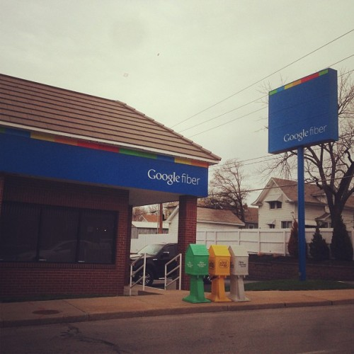 jacobmullins:  Welcome to the Google Fiberhood. (at Google Fiber Space)  I mean, cool. But it also sort of looks like they slapped some logos on top of an old, dilapidated Blockbuster. Also, is this the drab filter, or does Kansas City really look like this?