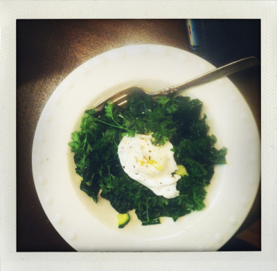 Breakfast of champions. Organic kale sautéed with green onion and parsley in coconut oil and an organic poached egg atop! Y U M.
