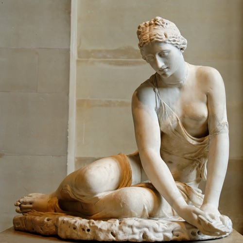 ancientart:  Nymph with a shell. Marble, Roman copy of the 1st century CE after the known Hellenistic type of a young girl playing a game of knuckle-bones. The head is antique but does not belong to the statue; left arm, right hand and shell are modern restorations, altering the original type. Courtesy & currently located at the Louvre, France. Photo taken by Jastrow
