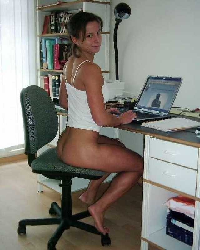 Bottomless on her laptop …