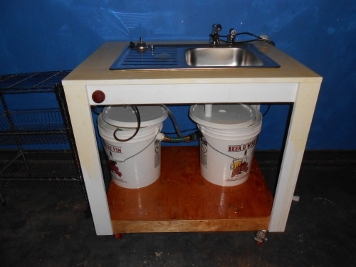 smsofthisearth:  Check out this self enclosed recycling sink my dad made for me.  It has wheels so I can roll it around the garage. He has to fix the lids a bit, but other than that it works. I've moved into my new house this weekend, and I'm busy fixing stuff around the house.  But I hope to be back to making work in a few weeks.  So please stay tuned.    Any chance we could see details such that one could construct something similar should one so desire? :)