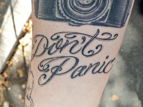 fuckyeahtattoos:  deseraestage:  Not to be confused with a Hitchhiker's Guide reference, this tattoo is a reminder: a permanent Post-It. I traded it for a six pack of Sam Adams at the very beginning of what would become my Internet famous gay divorce. It may have even helped save my life. It reminded me to breathe. I remember one day in that time period when I couldn't get the George Washington Bridge out of my head. I only lived about ten blocks away. Luckily, I had an unshakeable support system of people who were there to listen at all hours. A suicide is attempted every 40-60 seconds. A suicide is completed every 15-18 minutes. That means that around 96 people die from suicide every single day in this country. At least 6 people are intimately affected by each completed suicide. When you do the math, you start to see how overwhelming this problem is: 576 people are affected by suicide in a day; 17,280 in a month; 207,360 in a year. I truly believe that learning to talk openly about suicide could be a first step toward saving some lives. I'm so close to meeting the goal for my Live Through This Kickstarter campaign, but I still need help. There are over 120 suicide attempt survivors who want to share their stories with me—with us. If you've ever been affected by suicide, please consider donating—every single dollar counts. And if you don't have that dollar to spare, you can help by sharing the link anywhere and everywhere. Please help. You might save a life. For more information (or to donate), please visit http://bit.ly/livethroughthis.  If you're feeling suicidal, please talk to somebody. You can reach the National Suicide Prevention Lifeline at 1-800-273-8255.  It's the final week of backing for the LTT project, and there's less than $2000 to go before the campaign is funded. If you or someone you love has been affected by suicide, please consider reblogging and/or donating. Huge thanks to everyone who has helped thus far; you guys are amazing.