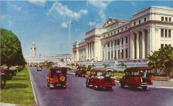 malacanan:   Jeepneys rumble past the Legislative Building, circa 1960. The Manila City Hall and the famous clock tower stand in the background.  Heavily shelled during the Second World War, the Legislative Building was rebuilt and made ready for use by 1949.  more photos at Arkitektura.ph
