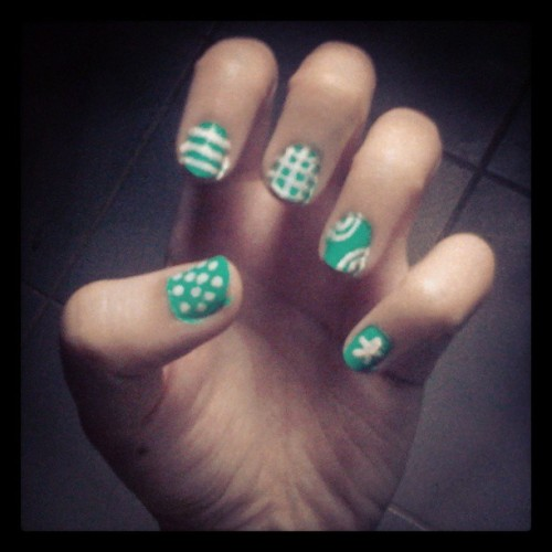 was bored so did my #nails in an awesome summer green with patterns of white #nailart