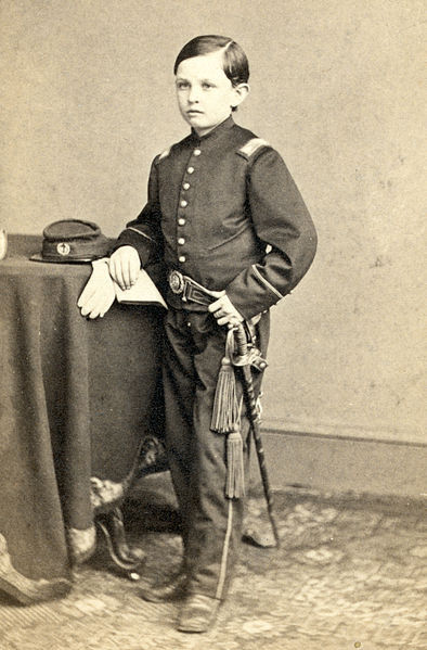 "thecivilwarparlor:  Tad Lincoln fourth and youngest son of Abraham Lincoln Photograph showing portrait of Tad Lincoln, standing, wearing a military-style uniform. Cropped, histogram fix Date circa 1860s. Nicknamed ""Tad"" by his father, for his small body and large head. Lincoln said as an infant, he wiggled like a tadpole. Born with a form of cleft lip and palate, causing him speech problems throughout his life. He had a lisp, and delivered his words rapidly and unintelligibly Tad and his brother Willie were considered ""notorious hellions"" during the period they lived in Springfield. They're recorded by Abraham's law partner William Herndon for turning their law office upside down; pulling the books off the shelves while their father appeared oblivious to their behavior. Tad outlived his father, but died at the age of 18 in 1871 variously referred to as tuberculosis, a pleuristic attack, pneumonia, or congestive heart failure."
