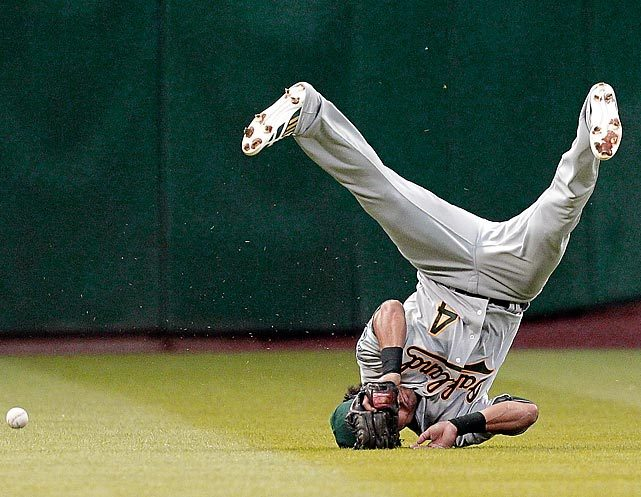 Coco Crisp dives but comes up a bit short on a line drive from former teammate Chris Carter during a Oakland-Houston game. (Bob Levey/Getty Images) GALLERY: Pictures of the Week