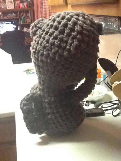 Weeping Angel take 3. I was playing with my S hook and used 6 strands of yarn held together. It's a little top heavy and measures in around 2 feet.