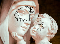 lawns:  Vandals draw KISS masks on Madonna and child statues—February, 2012