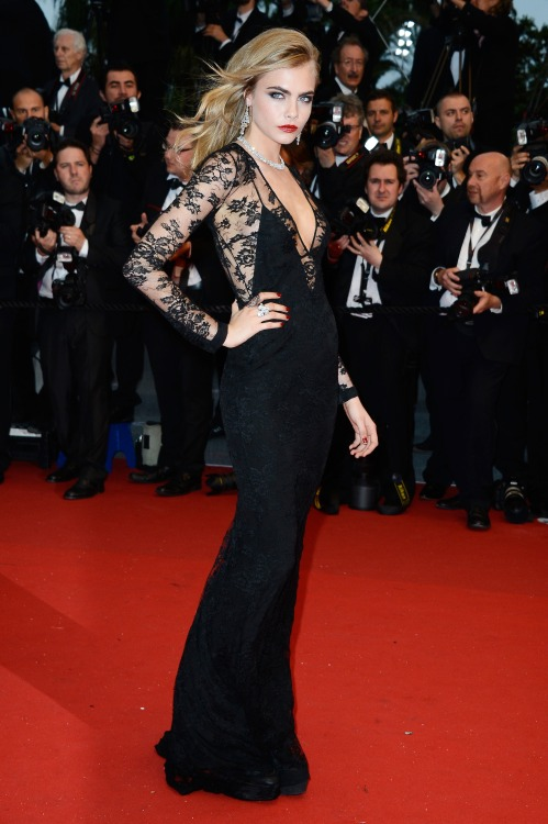 fashiondailymag:  Cara Delevingne wore a Burberry Silk lace plunge-neck column dress with cutaway back to The Great Gatsby premiere during the opening night of the Cannes Film Festival tonight in Cannes, France. ph Pascal Le Segretain | getty images