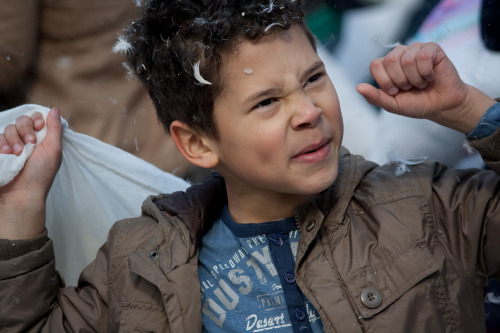 Young boy at the International pillow fight day 2013.