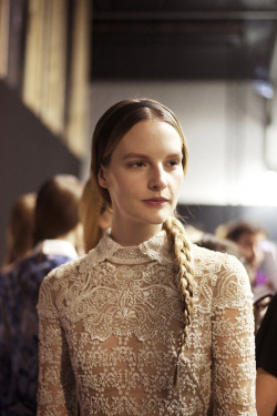 tmagazine:  A little lace and a long side braid at Valentino. And so the curtain sets on Paris Fashion Week. For more from Valentino and all our photos in review: http://nyti.ms/ZiyM4b