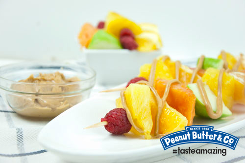 PB Fruit Skewers Granny smith apple, pineapple, orange, and raspberry fruit skewers with a Smooth Operator peanut butter drizzle. Conceived By Lee ZalbenPhotography By Andrea Hernandez