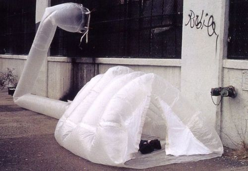 endthymes:  michael rakowitz, paraSITE homeless shelter (1997); polyethylene   paraSITE proposes the appropriation of the exterior ventilation systems on existing architecture as a means for providing temporary shelter for homeless people. Custom built inflatable shelters designed for homeless people attach to the exterior outtake vents of a building's HVAC system. The warm air leaving the building simultaneously inflates and heats the double membrane structure. Shelters were built and distributed to over 30 homeless people in Boston and Cambridge, MA and New York City.  pictured above: Joe H. using his paraSITE shelter in February 2000. Joe is a homeless man who lived on the streets near Battery Park City in Manhattan. In the 1970s, he became a contractor and was responsible for building over fifteen buildings in Brooklyn. He was diagnosed with cancer in the 1980s after being exposed to Agent Orange while serving in the Air Force in Vietnam. After forty-seven different operations to treat the cancer, the Veteran's Association of America ceased paying his medical bills and he went bankrupt.  (more on paraSITE project)