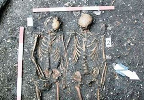 The Romanian Romeo and Juliet: Mystery of the young couple buried holding hands in courtyard of monastery Archaeologists excavating the inner courtyard of a former Dominican monastery may have discovered a Romanian Romeo and Juliet after unearthing the bodies of a young couple who were buried holding hands. Experts from the Cluj-Napoca Institute of Archaeology and History of Art are working on what they believe is the former cemetery of the monastery have already uncovered several bodies But discovering the couple holding hands was a surprise as double burials were extremely rare in that period. Main researcher Adrian Rusu said: 'It is a mystery - and rare for such burials at that time. 'We can see that the man had suffered a severe injury that left him with a broken hip from which he probably died. We believe the injury was caused after he was hit by something very blunt and hard.' Because of the fact that the young woman obviously died at the same time and was presumably healthy we are speculating that she possibly died of a broken heart at the loss of her partner.  (Source: The Daily Mail)