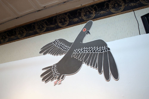 "Ben Woodward Pigeonpaint on plywood58"" x 50"" ish CURRENT BID: $275 (M&E) NEXT BID: $300BUY IT NOW: $625 INQUIRE"