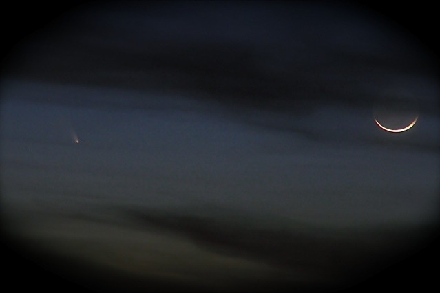 The comet Pan-STARRS is currently in view! Did you glimpse it last night? This beautiful photo was taken by Exploratorium Staff member Adam Esposito last night (March 12) from the Berkeley Hills with a telephoto lens. Uranus is actually right near the comet as well. Mars in the clouds below.   TO VIEW TONIGHT: most of USA and northern hemisphere should look west, about 30 minutes after sunset. You may be able to see it below the crescent moon. It's close to the sun so only after sunset is it briefly visible in the darkening sky.  To learn more about comets Pan-STARRS and ISON (viewable later this year) we've got you covered: www.exploratorium.edu/comets-2013