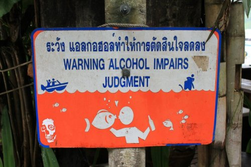 Warning: Alcohol Impairs Judgment  Heavy alcohol consumption increases risk of creating a creepy sign.
