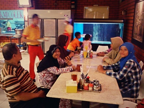 Having family dinner, X) at Bakmi Golek Kalimalang – View on Path.