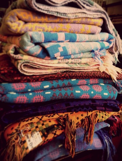 Beautiful vintage Welsh blankets at Perry Higgins antique shop in Penmaenmawr. I wanted them all! www.perryhigginsantiques.co.uk #welshblankets #vintage