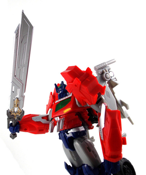Optimus Wields the Star Saber by Shadowbreakr