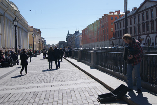 A young accordeon player plays in the streets of St. Petersburg, 08-05-2013