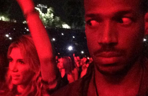 """suprchnk:  Marlon Wayans Fires Back at Racism Charges Over 'Unrhythmic White Woman' Instagram   The internet took the """"White Chicks"""" actor to task for an Instagram photo, but the comedian is not backing down    Internet backlash usually goes one of two ways: The person who incited the backlash immediately backs down, backpedals and apologizes, or they stick to their guns and go on the offensive. Marlon Wayans, Hollywood was the latest star to feel the ire of the Internet, when he Instagrammed a photo during Jay Z and Beyonce's Los Angeles concert Monday night. The photo features Wayans in selfie mode, throwing some side-eye at a young lady with her arms in the air next to him. """"Man I got the most UNRHYTHMIC WHITE WOMAN dancing next to me at the jay and bay concert…"""" Wayans tagged his photo. """"This bitch dancing to AC/DC."""" Needless to say, people were quick to call him out, even going as far of accusing the photo and caption of being blatantly racist or containing racial undertones. The """"unrhythmic white woman"""" in his photo, Delta Goodrem, an Australian pop star with a devoted following Down Under also took him to task. """"Absolutely NO reason why you should feel good about putting someone down. Little do you know, she is an Australian treasure,""""reads one tweetin response to Wayans' photo. Wayans went on the offensive, tweeting, """"I love that all these people calling me racist cuz I stated a fact. She can't dance. Apparently neither can u. Now fuck outta here. """"one day people are gonna understand… I simply don't give fuck. And I refuse to succumb to this new world order if not having an opinion """"All comedians, say what u say and let it be said. Never say sorry for a fact, just say fuck off. Be you, be true."""" Overall, Wayans seems pretty delighted at the so-called controversy. """"This shit is even funnier second time around after all the controversy surrounding it!"""" another tweet reads, along with a re-post of the photo. He also re-posted the original photo in black and whi"""