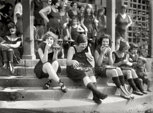 "fat-feminist:   ""In 1921, early suffragettes often donned a bathing suit and ate pizza in large groups to annoy men…it was a custom at the time.""  *suffragists suggragettes was a term coined by the media to belittle the feminist movement and turn these women into ""ettes"", feminine, docile and powerless."